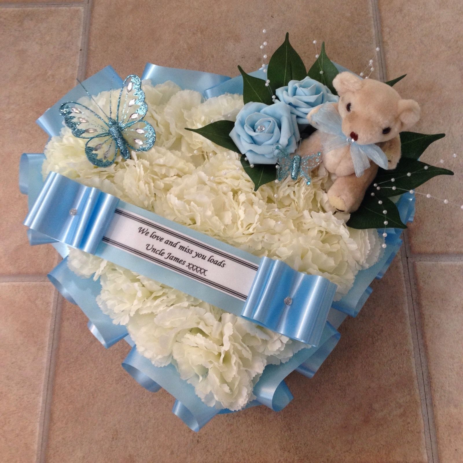 Silk funeral flowers heart wreath memorial tribute blue ivory silk funeral flowers heart wreathmemorialtribute blue ivory teddy butterfly izmirmasajfo Images
